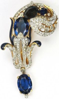 Trifari 'Alfred Philippe' Pave and Black Enamel Sapphire Swirl with Pendant Pin Clip ; dated 1941 Jewelry Armoire, Antique Jewelry, Vintage Jewelry, Chunky Jewelry, Fine Jewelry, Jewellery Uk, Bead Jewelry, Silver Jewellery, Vintage Costume Jewelry