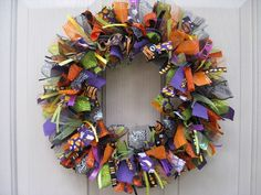 "Halloween Wreath, Fall Wreath, Fabric Wreath and Ribbon Wreath for Halloween by AWorkofHeartSA, $75.00  This wreath is sure to lend a spooky ""Fall-O-Ween"" feeling to your home!"