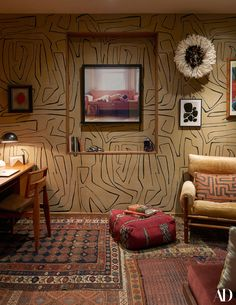 Home study covered in Kelly Wearstler wallpaper and filled with vintage textiles. See Inside Zachary Quinto and Miles McMillan's Art-Filled NoHo Apartment Zachary Quinto, Zachary Levi, Architectural Digest, Kelly Wearstler Wallpaper, Miles Mcmillan, Gravity Home, Vintage Textiles, Vintage Rugs, Blue Walls