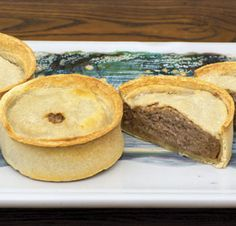 You've been patient while we found the best beef scotch pies worthy of the name Scottish Gourmet. Each pie is literally overfilled with tasty  filling made with beef, onions and just the right spices. Precooked but shipped frozen so you can reheat and enjoy them whenever you please. Set of eight 3 ounce pies. Packed two per plastic sleeve to protect he shells from drying out.   For $30 from Scottish Gourmet.