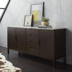 Calvin Klein Varick Stone Top Wooden Buffet Server. Keep your dining room organized and chic with the simple elegance of the Varick dining buffet/ server. Two deep cabinets and four drawers offer plenty of space for storing your dining necessities. The gorgeous white and gray travertine stone top compliments the natural wood veneer for a sleek modern look.