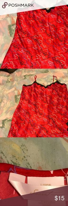 Beautiful & Elegant Simply gorgeous chemise ~ Rich red with elegant black lace at neckline and hemline. Printed with black , pink and white scrolling. Sexy little nightie. Size Large (12/14). Fabric content is 100% polyester. Excellent pristine condition ❣️ Intimates & Sleepwear Chemises & Slips