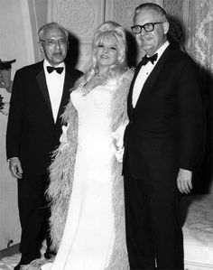 Mae West flanked by directors George Cukor and Robert Wise