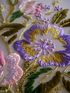 Flowers. Love the gold next to the lilac in this #embroidery. If you love goldwork, check out our course: https://www.mastered.com/courses/22 £120 for lifetime access.
