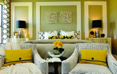 Black, white, yellow against light green walls. Nice idea on the wall panels to create interest and illusion of headboard.