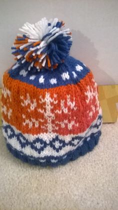 Bronco colors hat with a snowflake pattern by LavenderLassies