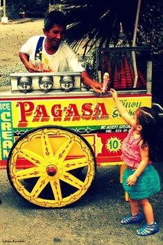 Mamang sorbetero (ice cream vendor) - they travel on foot!!! YES!!!!! brings back childhood memories!