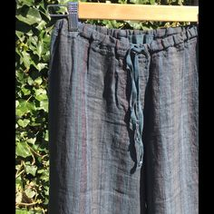 """CP Shades Jenn Linen Pant - Indigo Stripe CP Shades Jenn pant in linen, Indigo Stripes! Elastic and drawstring waist, on seam pockets, straight relaxed leg. Approx. measurements: Waist (stretched) is 30"""", Rise is 12.5"""", Inseam 23"""". EUC! Machine wash. Made in USA. No Trades. CP Shades Pants Ankle & Cropped"""