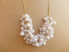 White pearl statement necklace, on gold chain, wedding jewelry, bridal necklace. Elegant modern classic jewelry.