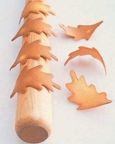 Use a leaf stencil and a rolling pin to create realistic tuile leaf cookies. Make these thin and crispy cookies to garnish our Orange-Walnut Buche de Noel or for any other special celebration. Leaf Cookies, Crispy Cookies, Fall Cookies, Holiday Cookies, Fall Recipes, Holiday Recipes, Holiday Treats, Christmas Desserts, Christmas Trees