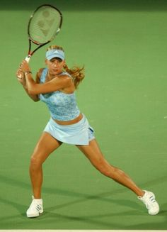 2000s  Anna Kournikova (above) and Maria Sharapova are two tennis players who became almost as famous for what they would wear on the court as they were for their stellar performances. While Kournikova favored short, tight, and midriff baring outfits, Sharapova designed all of her uniforms, adding menswear elements and Swarovski crystals.  Photo: Nick Laham/Getty Images
