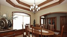 Glendale Dining Room - This Glendale dining room features a double treyed ceiling and stained wainscotting