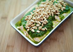 Hummus with Parsley Oil recipe - This hummus recipe is a long time favorite and will be the next thing that I make for my dinner party series.  This hummus can be made a week ahead of time and kept in an airtight container. #hummus #dip #condiment