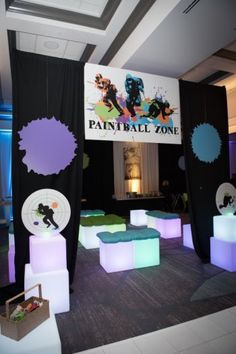"""The kids lounge at this Paintball Themed Bar Mitzvah was appropriately named the """"Paintball Zone"""" and included LED furniture. Read more party details at MitzvahMarket.com."""