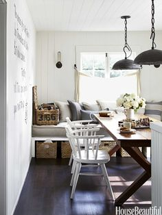 Love the color palette, rustic decor and that banquette/daybed! -- via House Beautiful