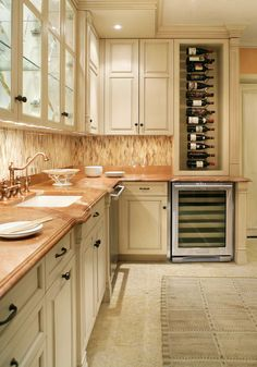A weathered finish on the cream cabinets give this kitchen an imperfect yet sophisticated look - Traditional Home®