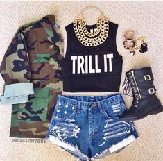 Highwasted shorts, combat boots, tank and camo jacket, and chains
