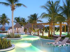 Excellence Playa Mujeres, Cancun - All Inclusive Resorts | Discover heaven on earth -  with seven gorgeous pools that wind through the resort with swim-up bars and suites! View Resort!