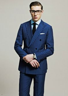 A classic Double Breasted suit with traditional pinstriping, 6 buttons, and peak lapels.