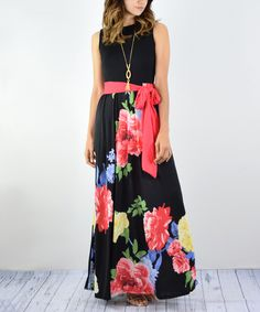 A vibrantly patterned skirt contrasts beautifully with a solid bodice in this easygoing maxi dress. Its tie waist accentuates your curves. Size S: 57'' long from high point of shoulder to hem96% polyester / 4% spandexHand washMade in the USA