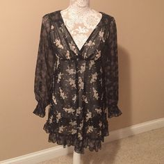 Charlotte Russe dress Charlotte Russe black semi sheer floral black dress.  Two different floral patterns. Ties in back. Super cute! Size 3, would fit and extra small or small. Price below or best offer. Charlotte Russe Dresses Mini