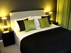 Green, white and black bedroom