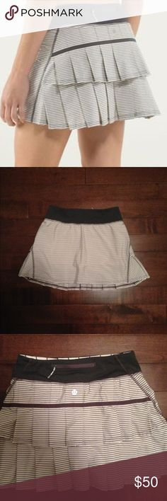"""Lululemon Pace Setter Skirt Angel wing stripe colorway (cream with warm gray stripes, stitching and waist band). Size 2T (tall, so it's longer), as confirmed by rip tag. Super cute moisture wicking design with ruffle back. Has luon shorts underneath. In VGUC with minor signs of wear. Measurements: 13"""" length, 13"""" waist (unstretched). lululemon athletica Skirts"""