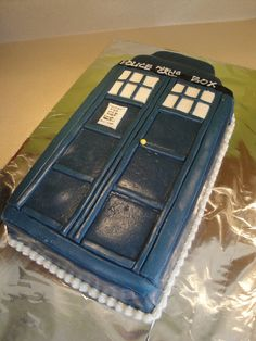 Doctor Who Tardis Cake. The only one I could find that wasnt vertical. Pleeeease friends?