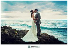 Wedding kiss on the rocky shores of an island paradise. Shot in the beautiful area of Puerto Plata, Dominican Republic.