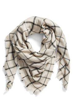 The classics always look right, just like this checked scarf trimmed with a bit of soft fringe.