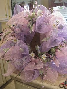 This would make a beautiful Easter wreath.  Must find mesh!!!!