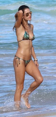 Bikini babe: Alessandra Ambrosio looked stunning when she enjoyed a walk along the beach in St Barts, in the French West Indies, on Monday
