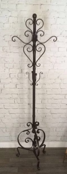 Large, ornate metal coatstand