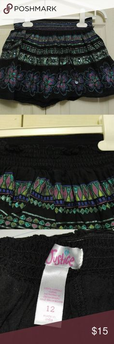 Black Floral Skirt by Justice 12 Beautiful Black Floral Skirt with sequin embellishments and back elastic Free of stains, rips, tears or fading Smoke Free Home Justice Bottoms Skirts