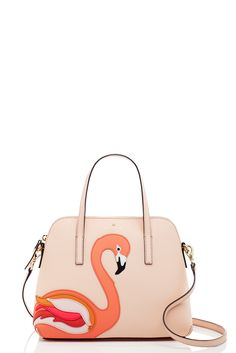 for our strut your stuff collection, our designers took inspiration from exotic animals, creating chic bags that allow you to stylishly show off your (slightly) wild side. case in point: our flamingo applique maise, an embellished version of our popular, clean-lined classic.