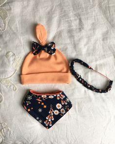 Organic baby hat, bandana bib, headband set. New baby girl set. Peach knot hat. Peach and navy floral baby bandana bib and braided headband. by MorozWear on Etsy https://www.etsy.com/listing/507524383/organic-baby-hat-bandana-bib-headband