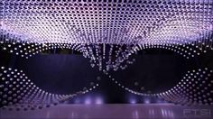 For the 2010 World Expo at Shangai, Japanese firms ADK and Murayama and Las-Vegas firm Fisher Technical Services, Inc. created an array of 1,008 15cm diameter actuated spheres, each suspended by its own micro winch. The show does not include data visualizations.  Kinetic sculptures made of arrays of suspended spheres abound. An early one is Joe Gilbertson's (2007). More recent ones include Kinetic Rain (2012) and Triptych (2014). Also check BMW's Kinetic Sculpture (2008) on this list.