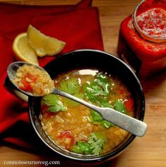 This healthy and delicious Mediterranean red lentil soup is made with tomatoes, warming Mediterranean spices and fiery harissa.