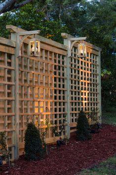 24 Unique Garden Trellis Ideas To Enhance Your Outdoors Garden Trellis With Solar Lanterns Unique Gardens, Beautiful Gardens, Unique Garden Decor, Diy Trellis, Privacy Trellis, Trellis Fence, Metal Trellis, Rose Trellis, Wisteria Trellis