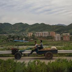 Photo by @dguttenfelder North Koreans drive a farm tractor and wagon on a highway near the city of Kaesong along the demilitarized zone that separates the two sides of the Korean Peninsula. For more photos and stories please follow @dguttenfelder on assignment for @natgeo who traveled this past week to isolated North Korea.