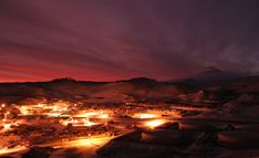 Scenes from Antarctica - Photos - The Big Picture - Boston.com The first glow of sunrise appears above McMurdo Station, Ross Island, Antarctica on July 13, 2007. (Chad Carpenter/National Science Foundation)