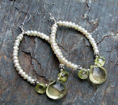 dangling from bali sterling earhooks are hand-forged sterling hoops beaded with genuine small creamy baby freshwater seed pearls and gorgeous hand-faceted lemon topaz & cubic zirconia briolettes accented by sm bali sterling beads (drop length about 2in excluding earwire)