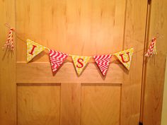 Pennant made from straws stuck onto card stocks with double-sided tape.