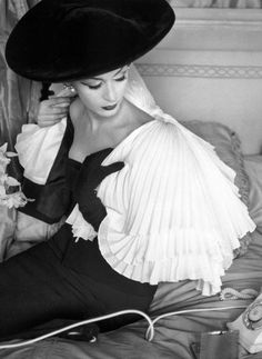 Dovima in capelet and dress by Jacques Fath, 1956.