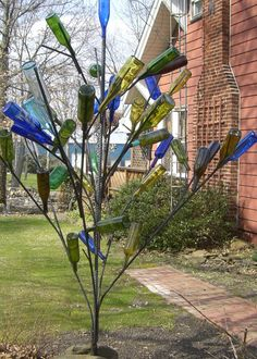 My husband made the bottle tree from rebar.