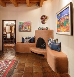 Kiva fireplace with built in bench seat...deepen for wood storage