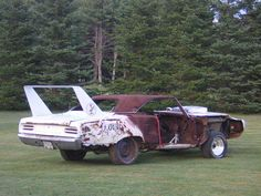 A Collection Of The Saddest Winged Cars You Will Ever See - Rod Authority 1969 Dodge Charger Daytona, Dodge Daytona, Retro Cars, Vintage Cars, Abandoned Cars, Abandoned Vehicles, Junkyard Cars, Plymouth Superbird, Rusty Cars