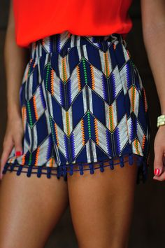 Native print shorts. Love the pop off color!