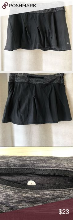 Lululemon Skirt Sz6 Size 6, Charcoal Color, Shorts underneath, Signs of Wear on Fabric only, there's some balling on the Fabric but it's only visible close up. Zipper pocket in the back. Looks really good with the power y Tank in my closet lululemon athletica Skirts Mini