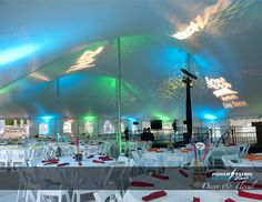 Festive uplighting and superhero themed gobo projections that we designed for Camp Courant's Buddy Bash. #lighting #blue  #green #projections #wedding #tent
